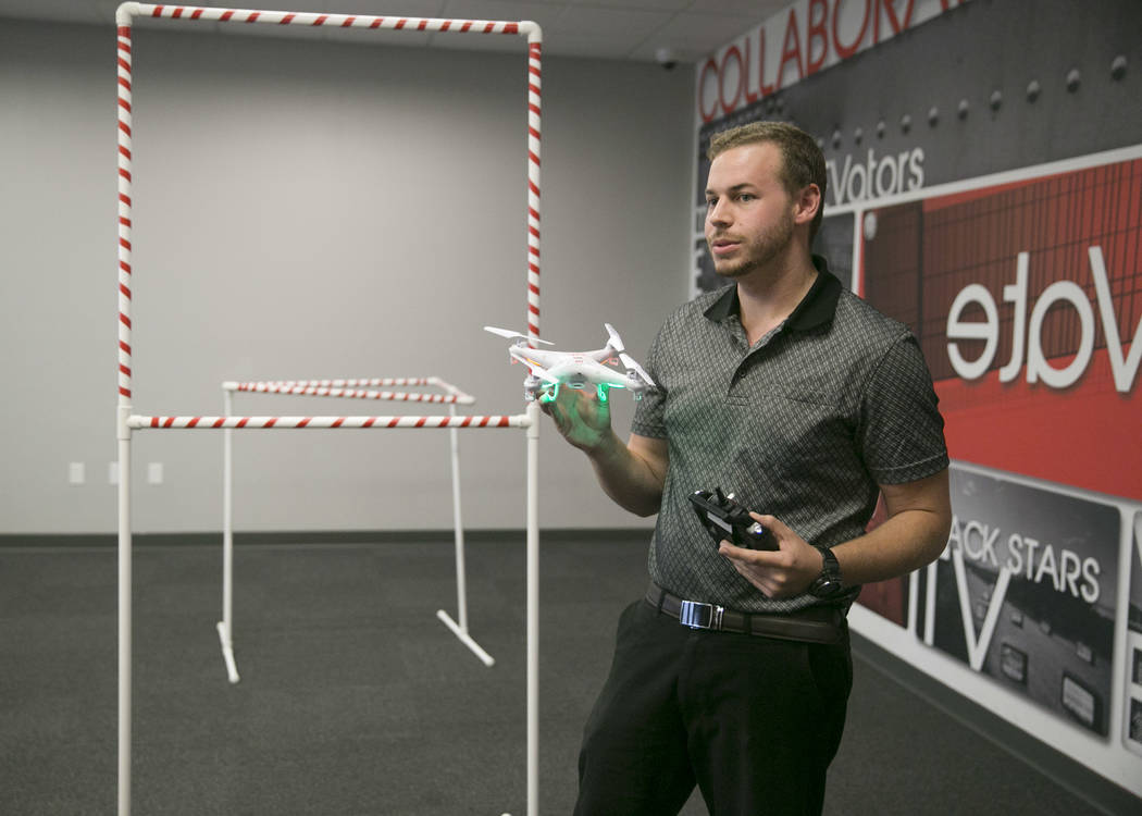 Stewart Carmichael-Green explains an obstacle course during a drone class at the The Innevation Center in Las Vegas, Wednesday, Aug. 16, 2017. (Gabriella Angotti-Jones/Las Vegas Review-Journal) @g ...