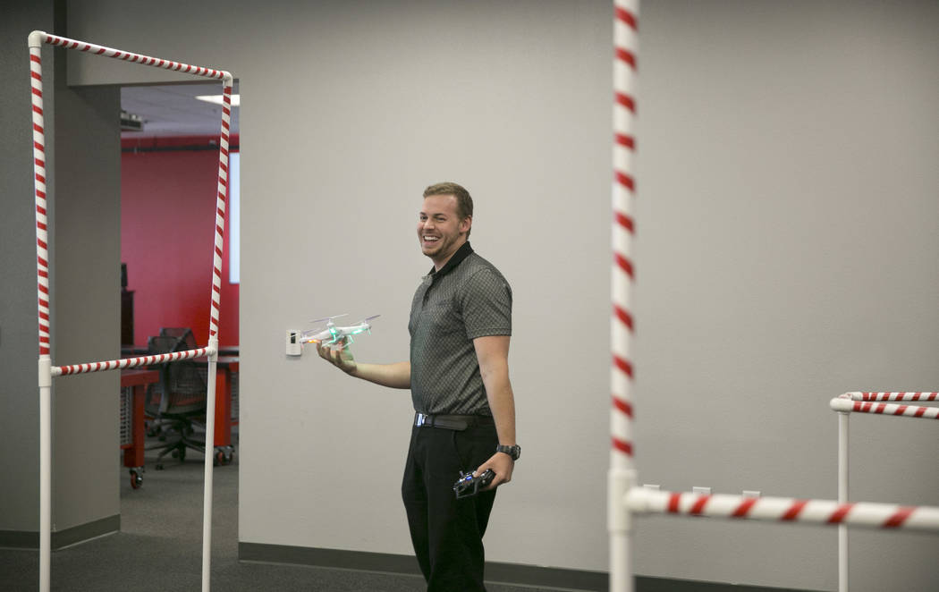 Stewart Carmichael-Green laughs after crashing his drone into a obstacle course during a drone class at the The Innevation Center in Las Vegas, Wednesday, Aug. 16, 2017. (Gabriella Angotti-Jones/L ...