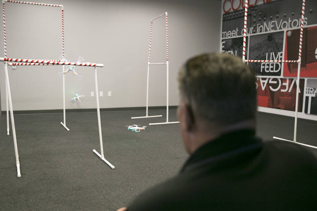 Dean Keck, deputy director of the FAA-Designated Nevada UAS Test Site at The Nevada Institute for Autonomous Systems (NIAS), flies a drone through an obstacle course during a drone class at the Th ...