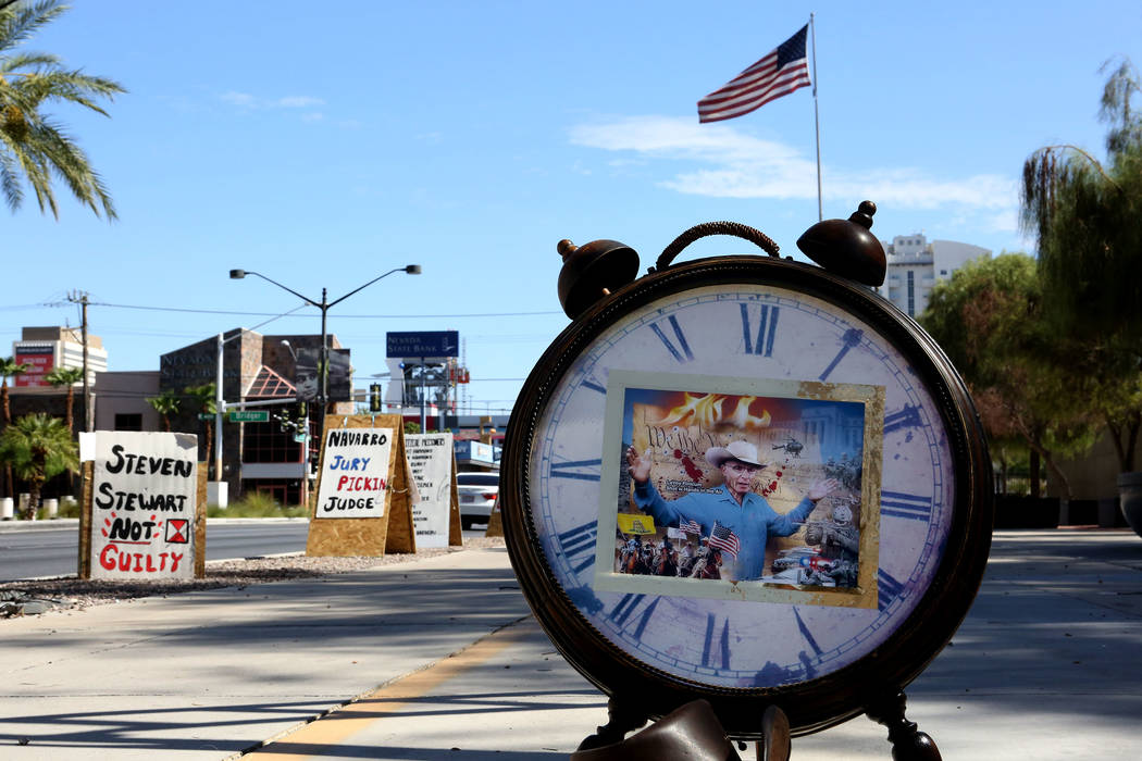 A image of LaVoy Finicum, the Arizona rancher who was shot and killed at the Malheur National Wildlife Refuge in Oregon,  sits on the face of a clock in front of the federal courthouse during the  ...