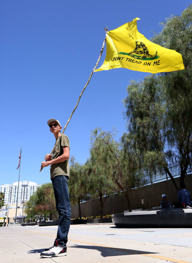 Kevin Baxter, 15, of North Las Vegas stands on the curb of Las Vegas Boulevard in front of the federal courthouse during the Bunkerville standoff retrial on Tuesday, Aug. 15, 2017. Michael Quine L ...