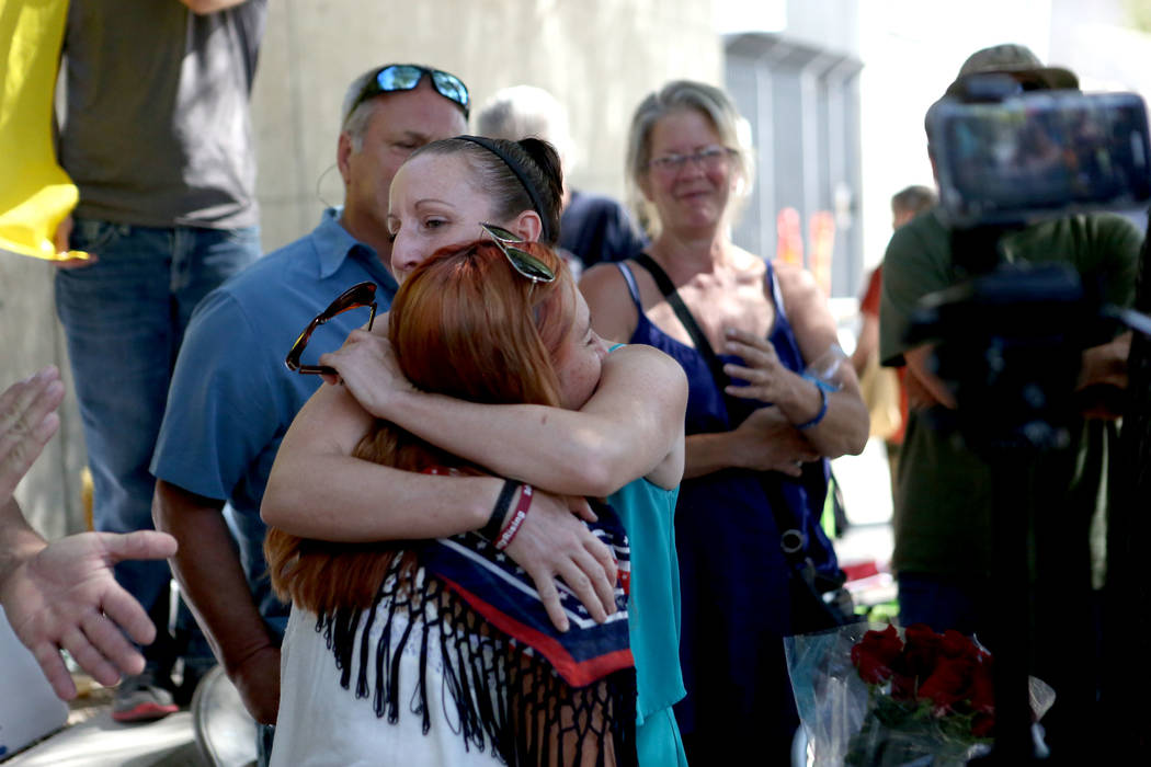Maureen Peltier embraces Andrea Parker, wife of Eric Parker one of the men on trial during the Bunkerville standoff retrial in Las Vegas on Tuesday, Aug. 15, 2017. Michael Quine Las Vegas Review-J ...