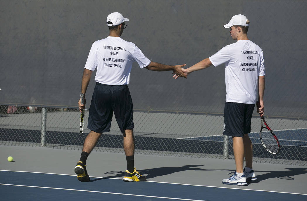 Doubles players Ahmed Nadeem-Tariq, left, and Peyton Sachs shake hands after a playʤuring practice at the Meadows School on Thursday, Aug. 17, 2017, in Las Vegas. Bridget Bennett Las Vegas R ...