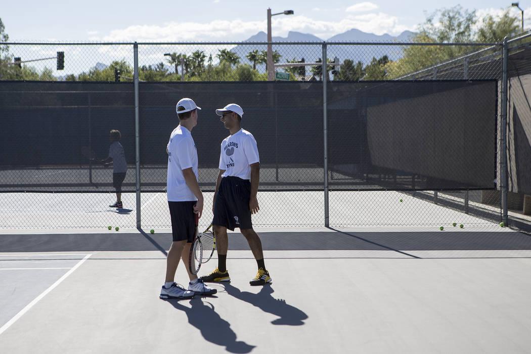 Doubles players Peyton Sachs, left, and Ahmed Nadeem-Tariq chatʤuring practice at the Meadows School on Thursday, Aug. 17, 2017, in Las Vegas. Bridget Bennett Las Vegas Review-Journal @bridg ...