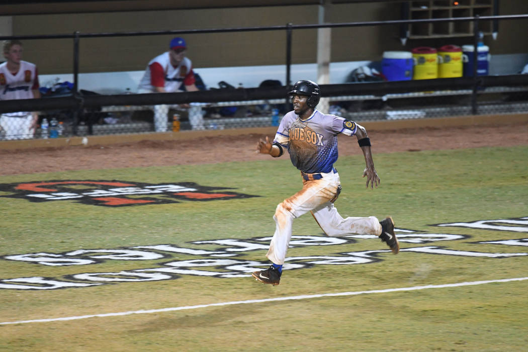 Southern Nevada Blue Sox's JJ Smith runs home to score the go-ahead run against Omaha, Neb. during the championship game of the American Legion World Series  in Shelby, N.C. on Tuesday, Aug. 15, 2 ...