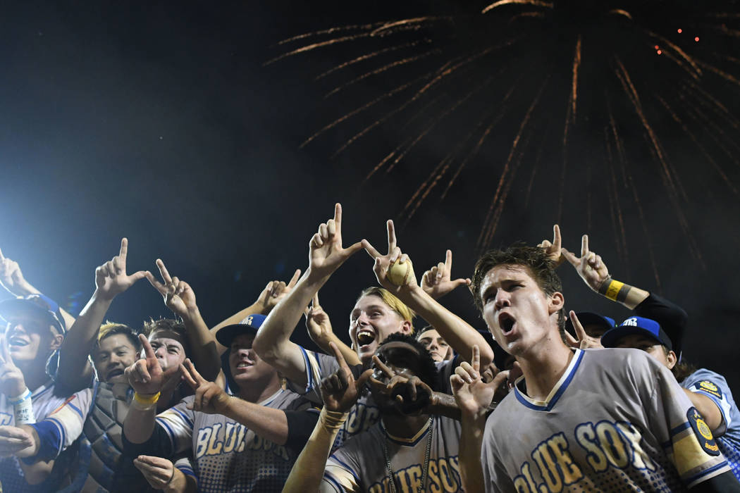 The Southern Nevada Blue Sox players celebrate following their win in a baseball game against Omaha, Neb. in the American Legion World Series championship in Shelby, N.C. on Tuesday, Aug. 15, 2017 ...
