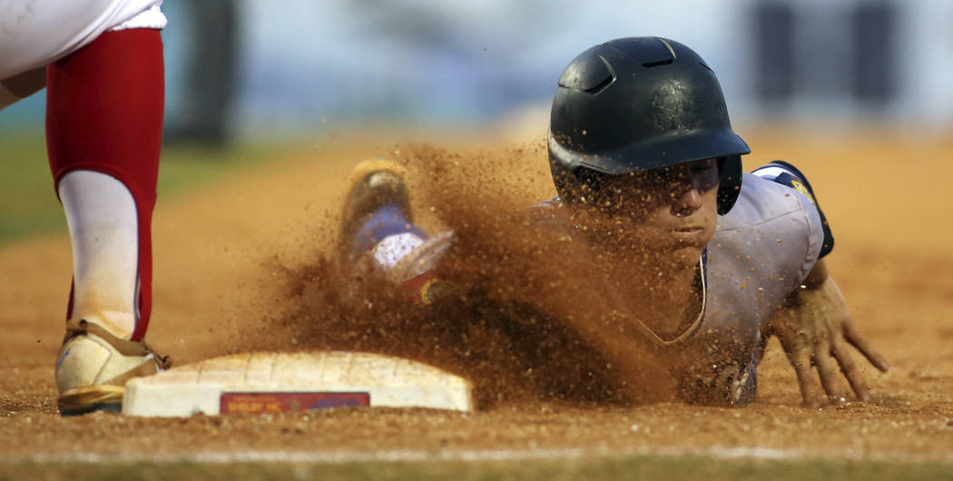 Henderson, Nevada's David Hudleson slides back to first safe during a baseball game against Omaha, Neb. in the American Legion World Series championship in Shelby, N.C. on Tuesday, Aug. 15, 2017.  ...