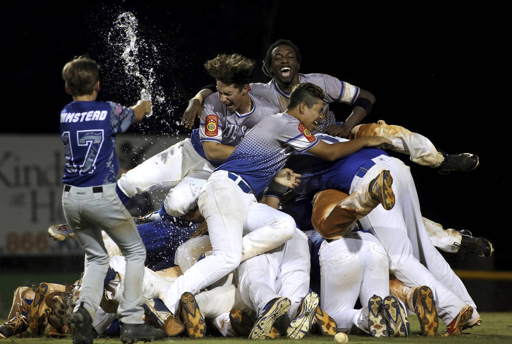 The Southern Nevada Blue Sox players celebrate on after their 2-1 win over Omaha, Neb., for the 2017 American Legion World Series championship title baseball game in Shelby, N.C. on Tuesday, Aug.  ...