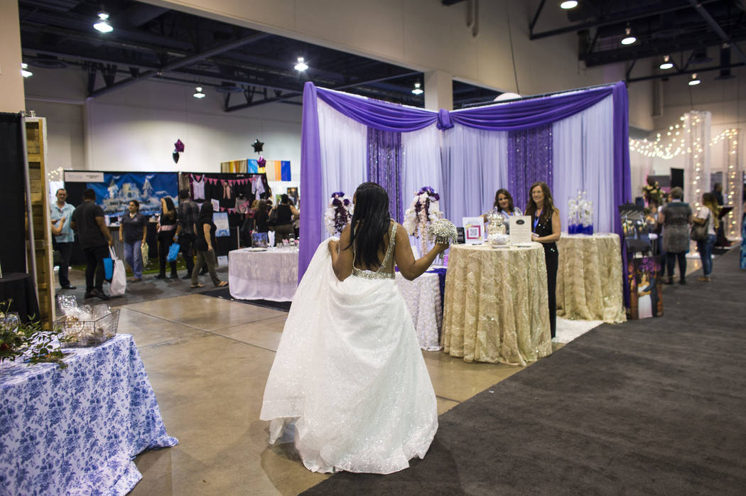 Mayani Gray walks the show floor while modeling a dress during the Bridal Spectacular wedding expo at Cashman Center in Las Vegas on Saturday, Aug. 19, 2017. Chase Stevens Las Vegas Review-Journal ...