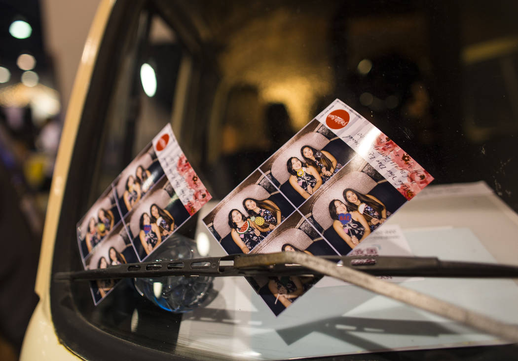 A pair of prints from The Photo Bus, a mobile photo booth in a vintage Volkswagen bus, during the Bridal Spectacular wedding expo at Cashman Center in Las Vegas on Saturday, Aug. 19, 2017. Chase S ...