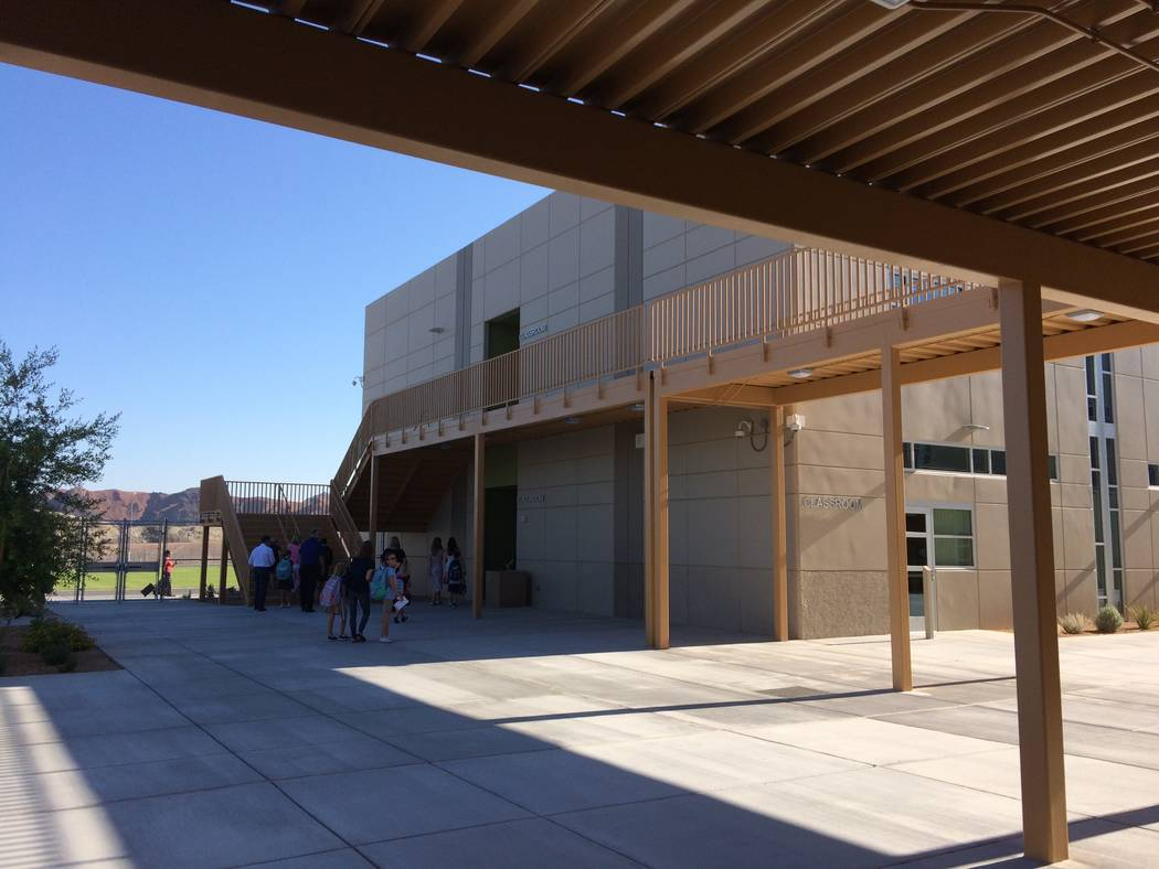 Parents and children are seen Aug.14, 2017, on the campus of Josh Stevens Elementary School, newly opened and named for a student who died in 2008. Josh was a known for being a friend to everyone  ...