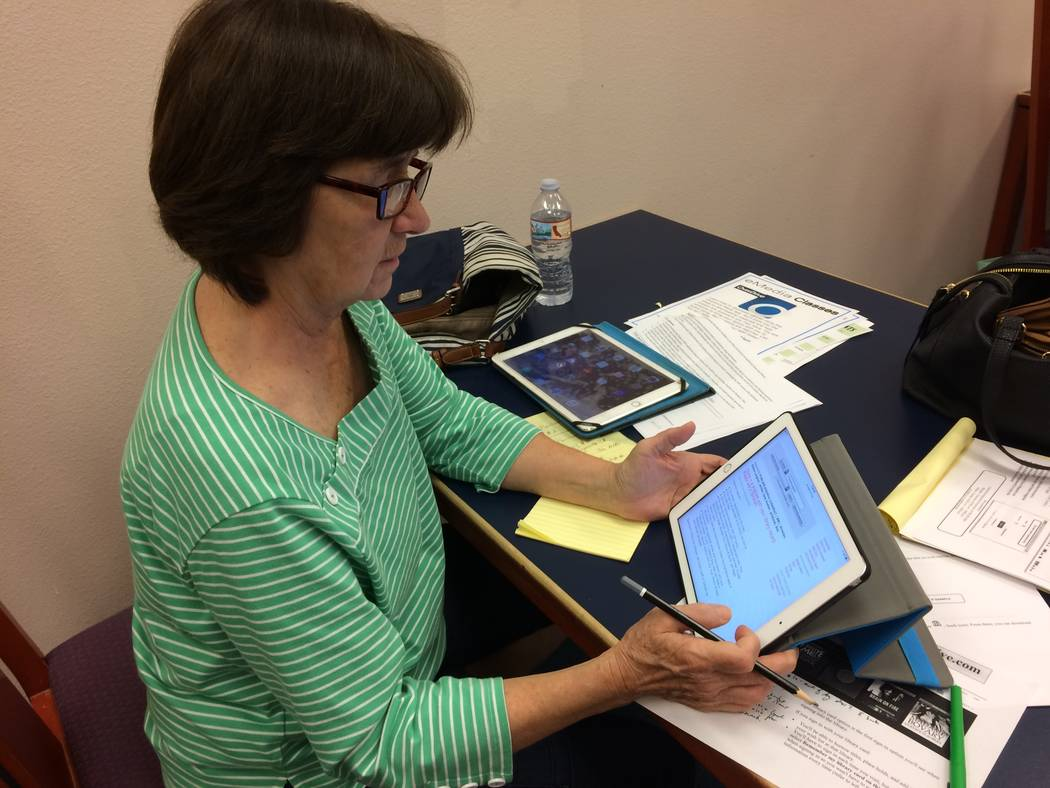 "Mary Mercier follows along on her device during a class called Downloading eMedia July 27, 2017, at Summerlin Library. Maria ""Ria"" Eufemio facilitated the free class,as she's been doing for  ..."