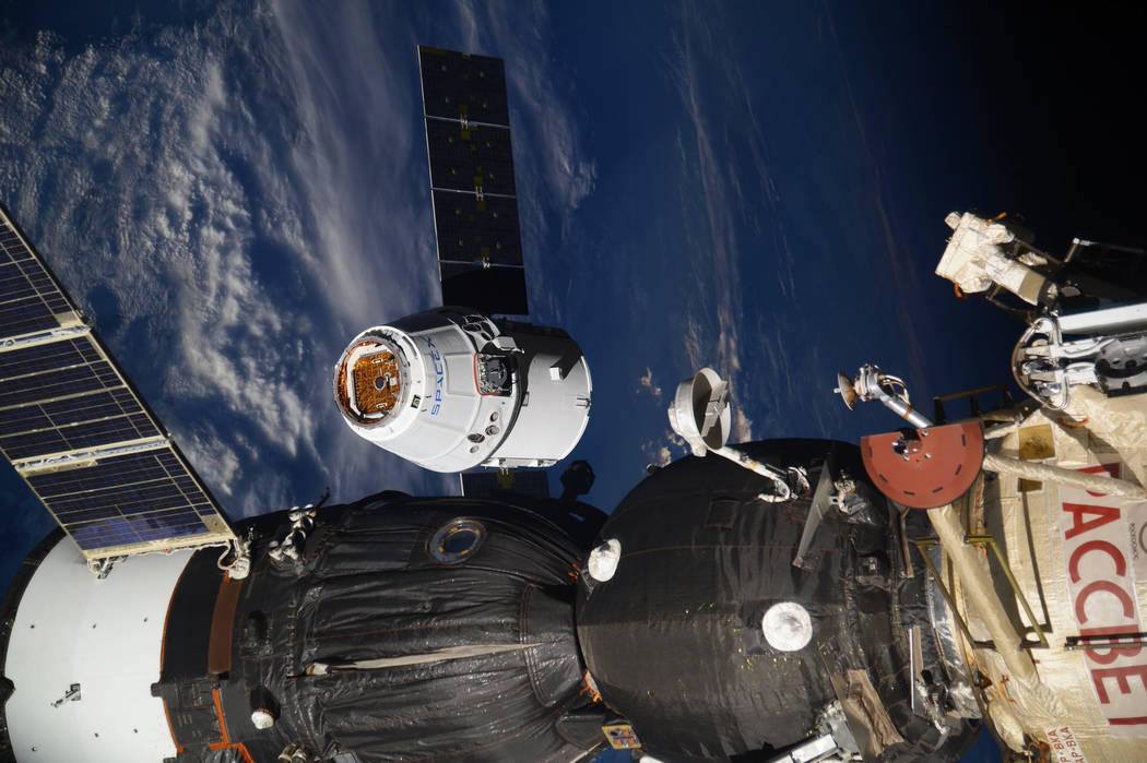 In this photo taken by Russian astronaut Sergey Ryazanskiy, the SpaceX Dragon capsule arrives at the International Space Station on Wednesday, Aug. 16, 2017. The capsule pulled up Wednesday follow ...