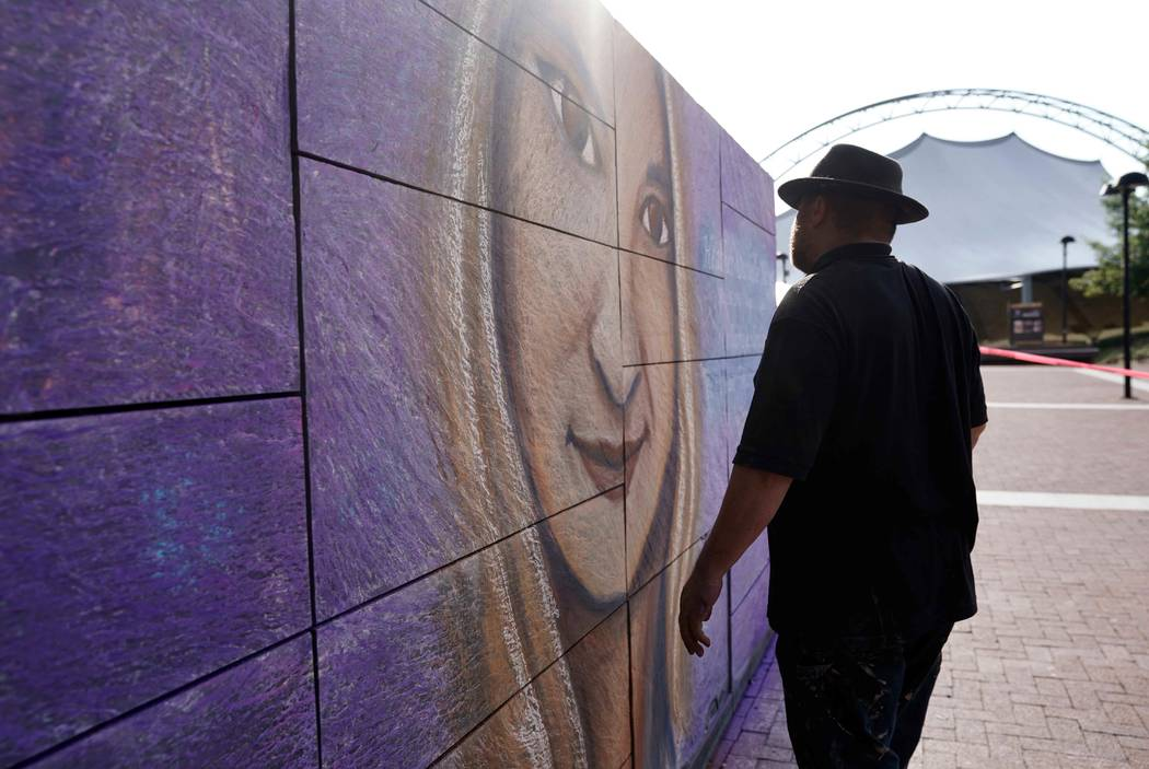 An artist looks at a mural he did of car attack victim Heather Heyer prior to a memorial service for Heyer in Charlottesville, Virginia, Aug. 16. 2017. (Jonathan Ernst/Reuters)