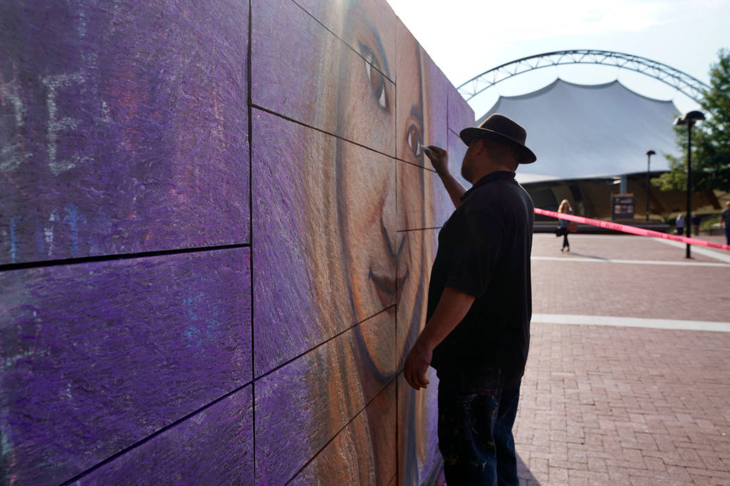 An artist works on a mural of car attack victim Heather Heyer prior to a memorial service for Heyer in Charlottesville, Virginia, Aug. 16. 2017. (Jonathan Ernst/Reuters)