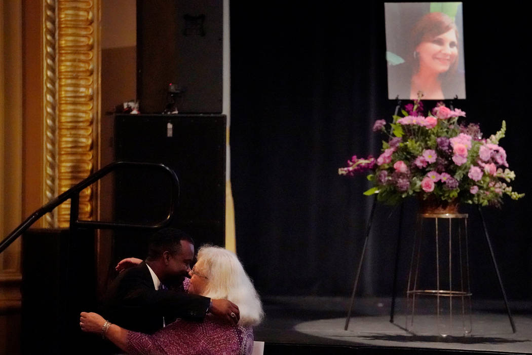 Car attack victim Heather Heyer's mother Susan Bro (2nd L) embraces Heyer's coworker Alfred Wilson (L) after he spoke during a memorial service for her daughter at the Paramount Theater in Charlot ...