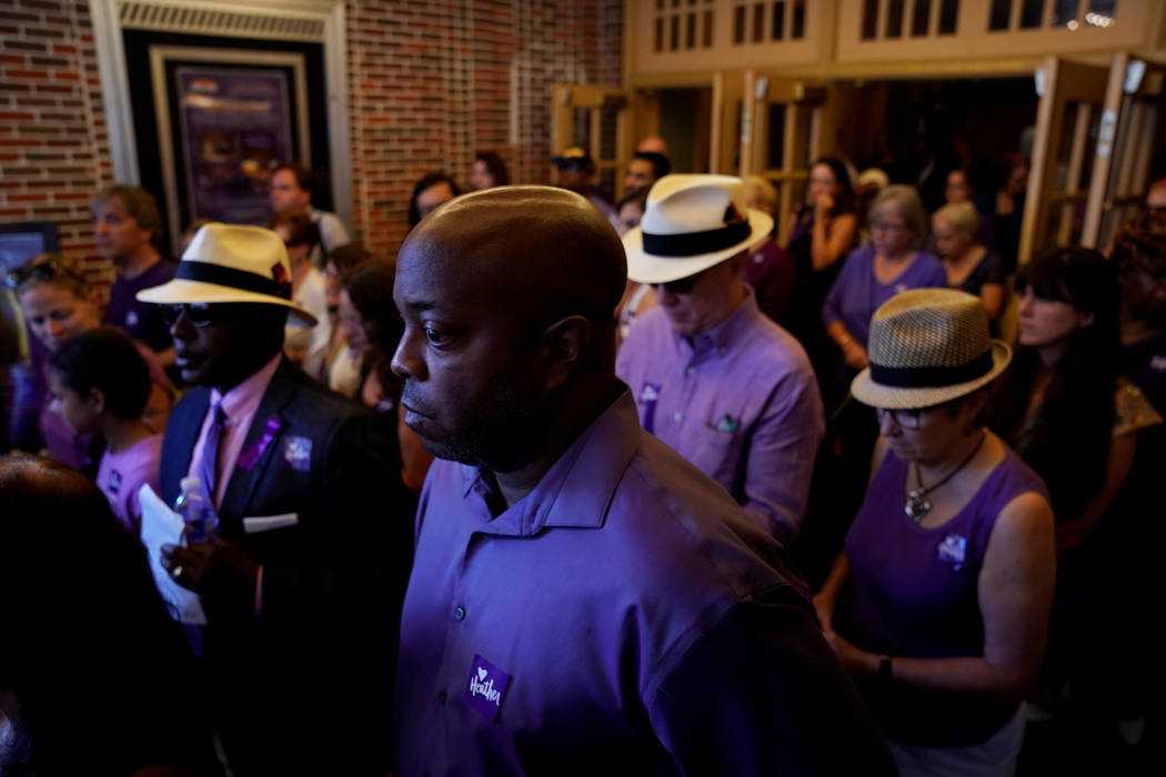 Mourners, many dressed in purple, depart after a memorial service for car attack victim Heather Heyer at the Paramount Theater in Charlottesville, Virginia, Aug. 16, 2017. (Jonathan Ernst/Reuters)