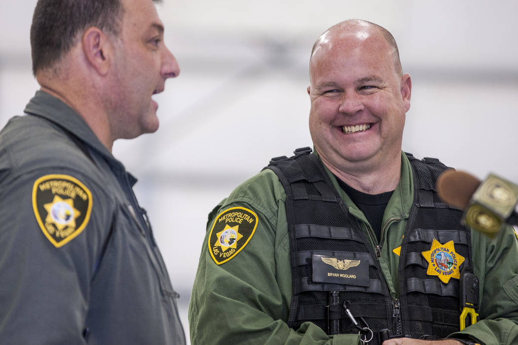 Bryan Woolard, a helicopter pilot, right, laughs with Chief Pilot Steve Morris Jr. before unveiling the new Las Vegas Metropolitan Police helicopter at the North Las Vegas Airport on Wednesday, Au ...