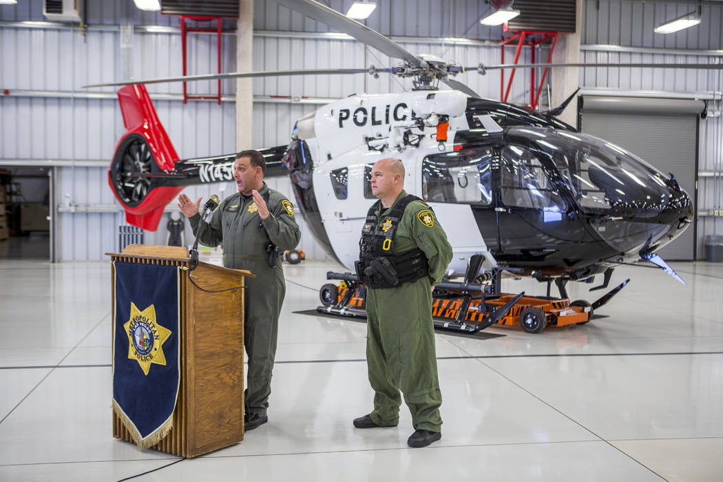 Chief Pilot Steve Morris Jr., left, speaks about the new Las Vegas Metropolitan Police helicopter while pilot Bryan Woolard stands by at the North Las Vegas Airport on Wednesday, Aug. 16, 2017.  P ...