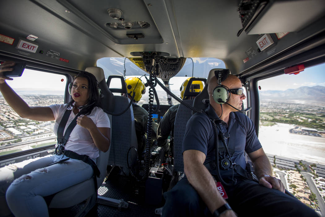 Chernéy Amhara of FOX5, left, and police spokesman Larry Hadfield, right in the new Las Vegas Metropolitan Police helicopter on Wednesday, Aug. 16, 2017.  Patrick Connolly Las Vegas Review-Jo ...