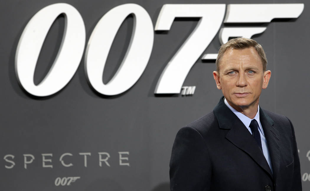 """Actor Daniel Craig poses for the media as he arrives for the German premiere of the James Bond movie """"Spectre"""" in Berlin, Oct. 28, 2015. Craig announced he returning to play James Bond in the fran ..."""