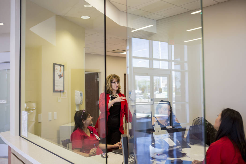 Laura Hennum, market CEO for Dignity Health's St. Rose Dominican Hospital's neighborhood hospitals, speaks with staff of its West Flamingo campus neighborhood hospital located at 9892 W. Flami ...
