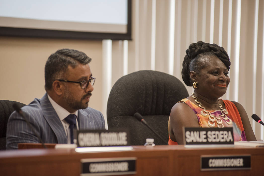 Commissioners Sanje Sedera, left, and Chairwoman Dora LaGrande at the Southern Nevada Regional Housing Authorityճ new board budget meeting at the headquarters on Thursday, Aug. 17, 2017, in  ...