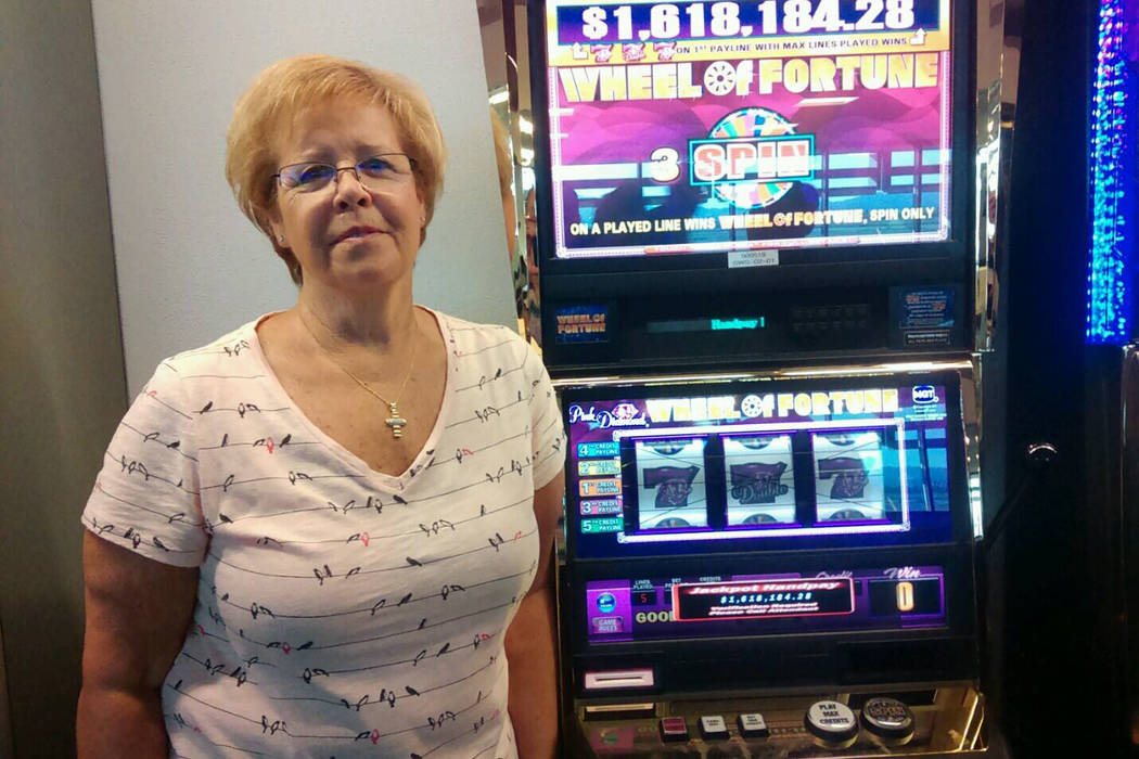 Sandra A. of Dublin, California, won more than $1.6 million playing a Wheel of Fortune slot machine yesterday in McCarran International Airport's C Concourse. (Facebook/McCarran International Airport)