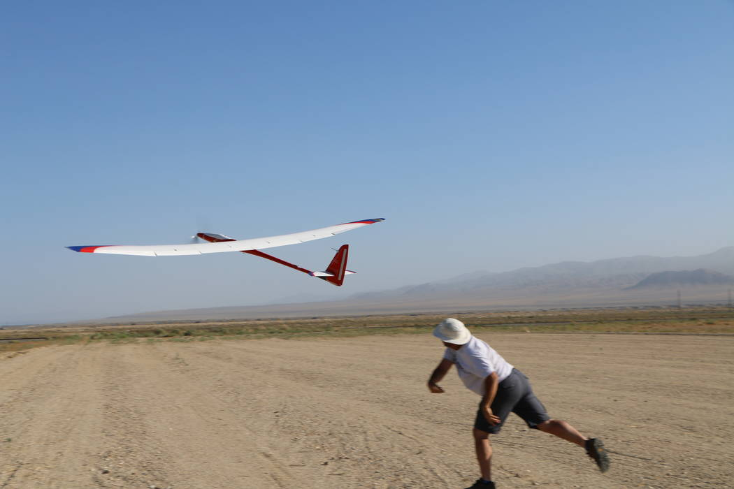 A Microsoft researcher launches a glider equipped with artificial intelligence Thursday, Aug. 10, 2017 in the Hawthorne Advanced Drone Multiplex Test Range located in Hawthorne, Nevada. Mark Barke ...