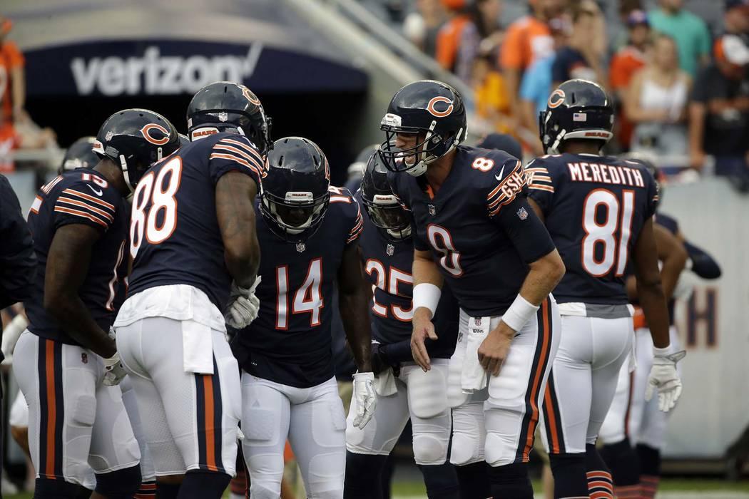 Chicago Bears quarterback Mike Glennon (8) huddles before an NFL preseason football game against the Denver Broncos, Thursday, Aug. 10, 2017, in Chicago. (AP Photo/Nam Y. Huh)