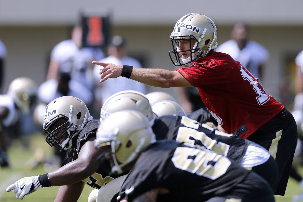 New Orleans Saints quarterback Drew Brees (9) reacts during an NFL football training camp in Metairie, La., Friday, July 28, 2017. (AP Photo/Jonathan Bachman)
