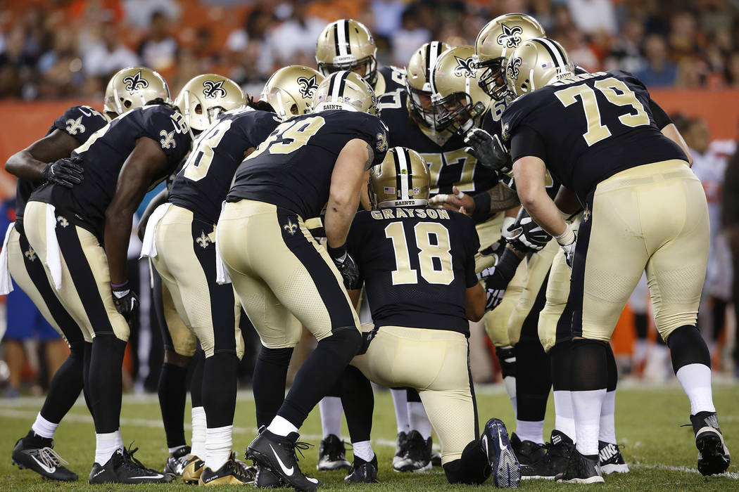 New Orleans Saints quarterback Garrett Grayson (18) calls the play in the huddle against the Cleveland Browns during the first half of an NFL preseason football game, Thursday, Aug. 10, 2017, in C ...
