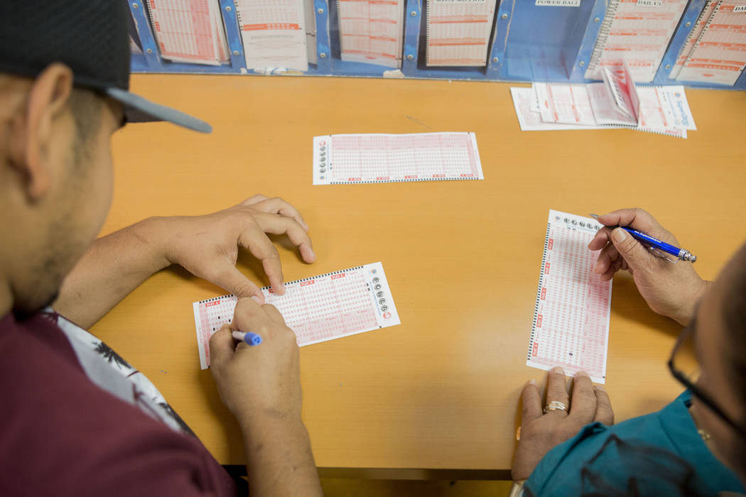 People fill out their numbers on a Powerball ticket at the Primm Valley Lotto Store, Wednesday, Aug. 16, 2017. Elizabeth Brumley Las Vegas Review-Journal
