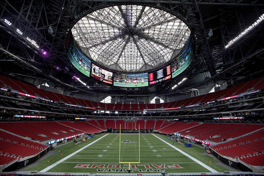 The Mercedes-Benz Stadium, the new home of the Atlanta Falcons football team and the Atlanta United soccer team, nears completion in preparation for its opening in Atlanta, Tuesday, Aug. 15, 2017. ...