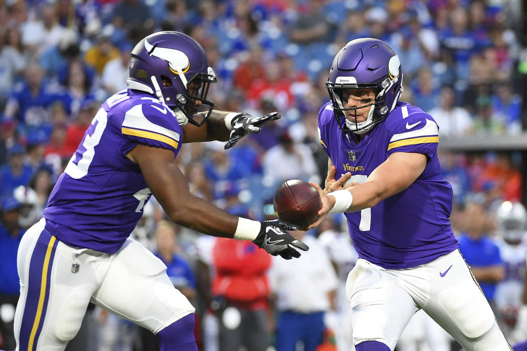 Minnesota Vikings quarterback Case Keenum, right, hands the ball to running back Bishop Sankey, left, during the first half of a preseason NFL football game Thursday, Aug. 10, 2017, in Orchard Par ...