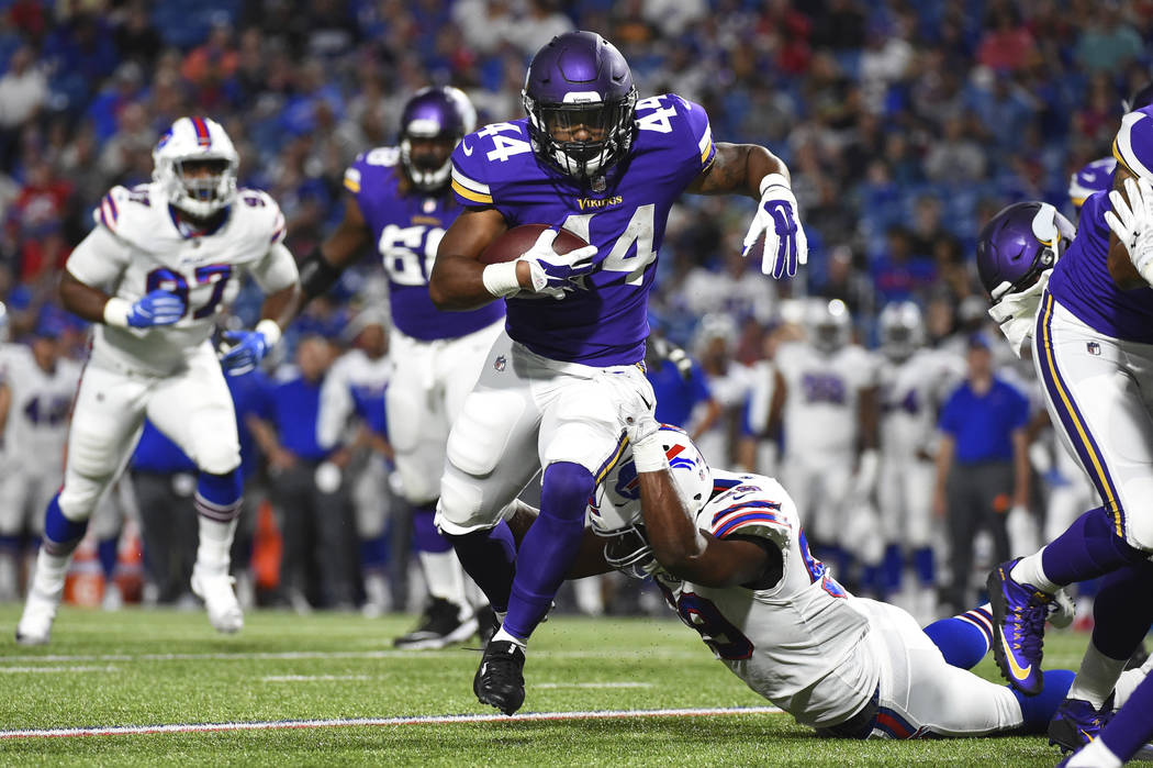 Minnesota Vikings running back Terrell Newby (44) runs with the ball from the grasp of Buffalo Bills linebacker Reggie Ragland (59) during the second half of a preseason NFL football game Thursday ...