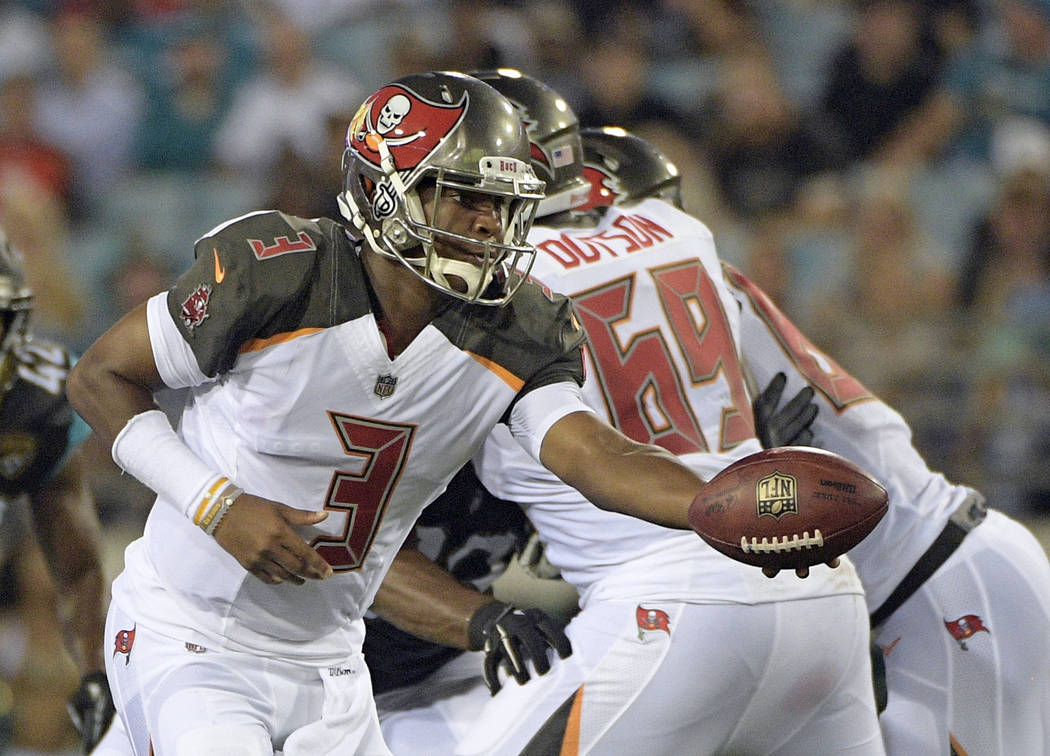 Tampa Bay Buccaneers quarterback Jameis Winston (3) hands off the ball during the first half of an NFL preseason football game against the Jacksonville Jaguars, Thursday, Aug. 17, 2017, in Jackson ...