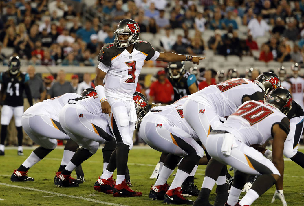 Tampa Bay Buccaneers quarterback Jameis Winston (3) calls a play against the Jacksonville Jaguars during the first half of an NFL preseason football game, Thursday, Aug. 17, 2017, in Jacksonville, ...