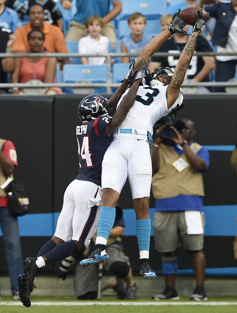 Carolina Panthers wide receiver Kelvin Benjamin (13) makes a touchdown catch against Houston Texans cornerback Johnathan Joseph (24) during the first half of an NFL preseason football game, Wednes ...
