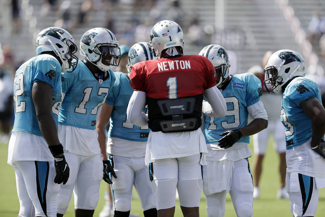 Carolina Panthers quarterback Cam Newton (1) calls a play during a combined NFL football training camp with the Tennessee Titans Thursday, Aug. 17, 2017, in Nashville, Tenn. (AP Photo/Mark Humphrey)