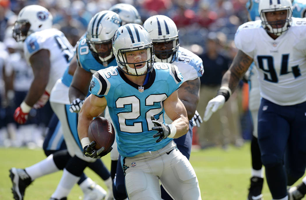 Carolina Panthers running back Christian McCaffrey (22) carries the ball against the Tennessee Titans in the first half of an NFL football preseason game Saturday, Aug. 19, 2017, in Nashville, Ten ...