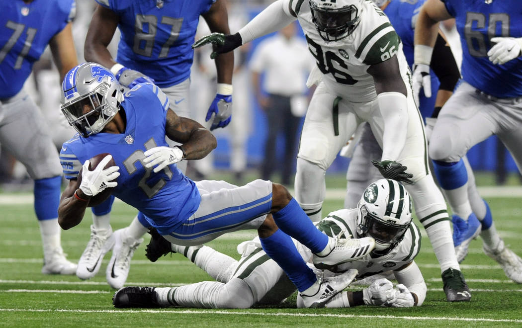 Detroit Lions running back Ameer Abdullah (21) is stopped by New York Jets safety Jamal Adams, bottom, during the first half of an NFL preseason football game, Saturday, Aug. 19, 2017, in Detroit. ...