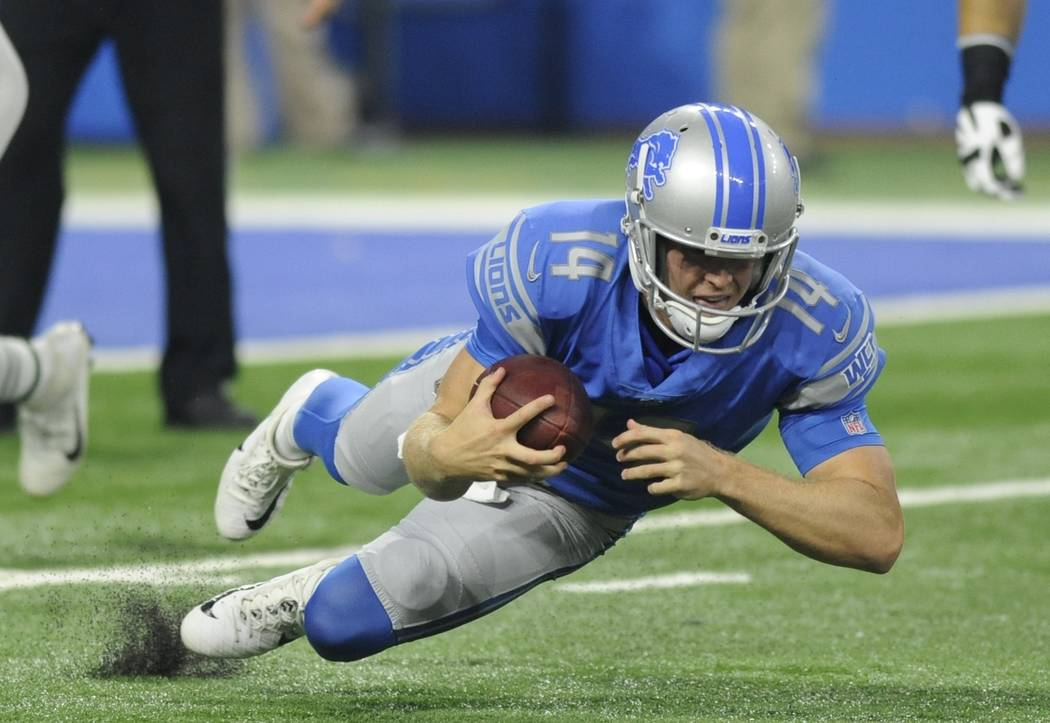 Detroit Lions quarterback Jake Rudock recovers a fumble during the first half of an NFL preseason football game against the New York Jets, Saturday, Aug. 19, 2017, in Detroit. (AP Photo/Jose Juarez)