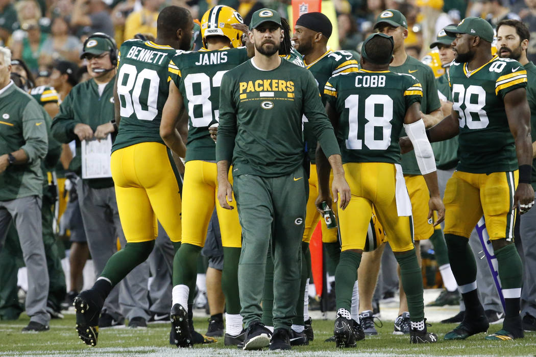 Green Bay Packers' Aaron Rodgers is seen on the sidelines during the first half of a preseason NFL football game against the Philadelphia Eagles Thursday, Aug. 10, 2017, in Green Bay, Wis. (AP Pho ...