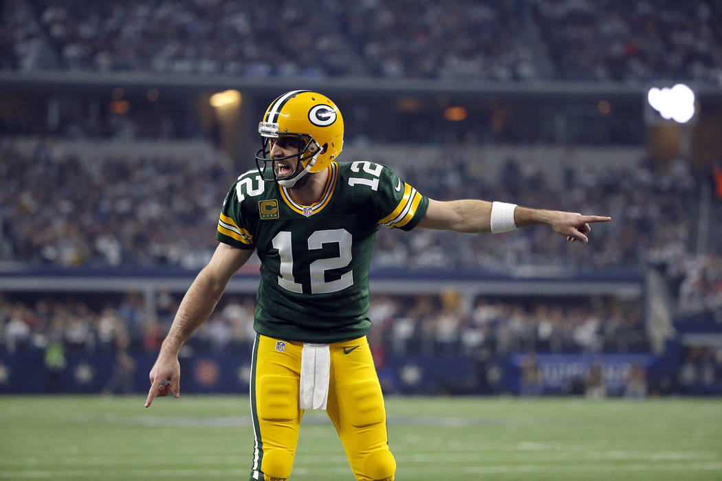 Green Bay Packers quarterback Aaron Rodgers (12) signals at the line of scrimmage during an NFL football game against the Dallas Cowboys on Sunday, Jan. 15, 2017, in Arlington, Texas. (AP Photo/Ro ...