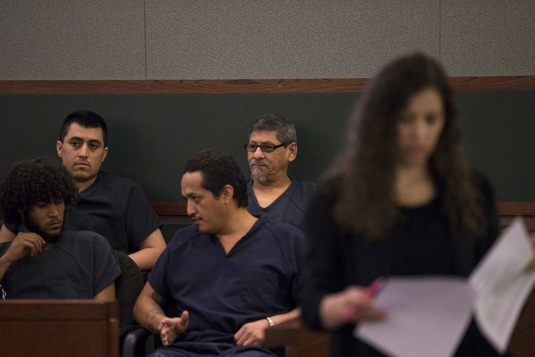 Jose Azucena, center, waits in court before his sentencing at the Regional Justice Center in Las Vegas on Thursday, Aug. 17, 2017. Richard Brian Las Vegas Review-Journal @vegasphotograph