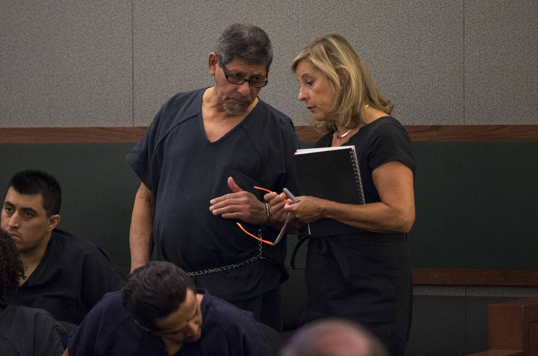 Jose Azucena, left, speaks to District Judge Richard Scotti through a Spanish language interpreter during his sentencing at the Regional Justice Center in Las Vegas on Thursday, Aug. 17, 2017. Ric ...