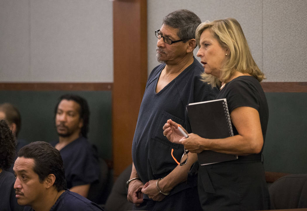 Jose Azucena, left, listens to District Judge Richard Scotti through a Spanish language interpreter during his sentencing at the Regional Justice Center in Las Vegas on Thursday, Aug. 17, 2017. Ri ...