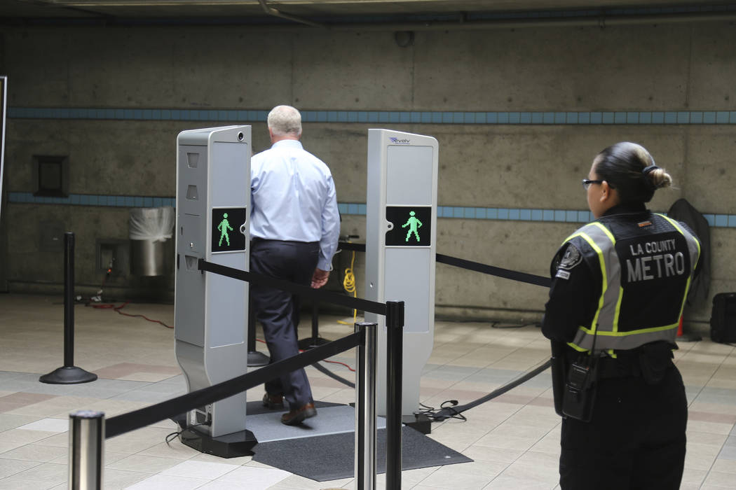 Chris McLaughlin, a vice president with Evolv Technology, test the company's body scanner at Union Station subway station in Los Angeles Wednesday, Aug. 16, 2017. (AP Photo/Mike Balsamo)