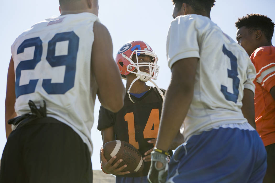 Bishop Gorman quarterback Dorian Thompson Robinson (14) talks with teammates during practice at Fertitta Field at Bishop Gorman High School Monday, Aug. 21, 2017, in Las Vegas. Bridget Bennett Las ...